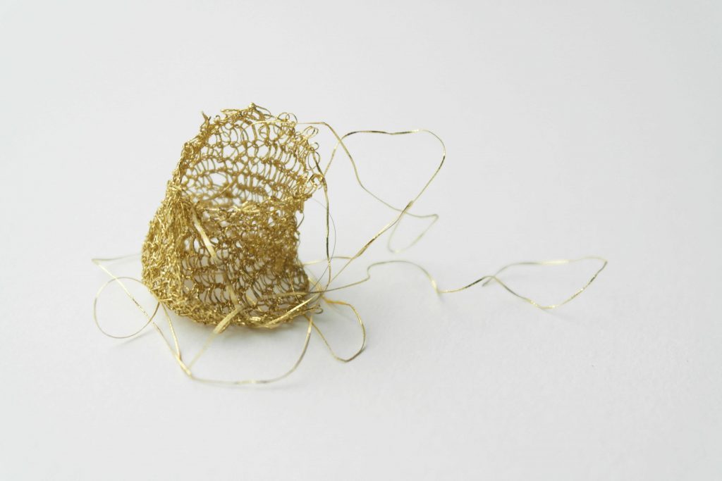 Knitted ring based on a piece of 16th century fabric found in a cesspool in the old center of Amsterdam
